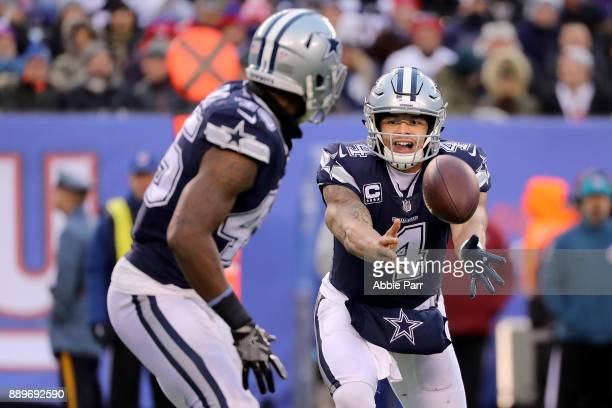 Dak Prescott pitches the ball to Rod Smith of the Dallas Cowboys in the second half during their game at MetLife Stadium on December 10 2017 in East...