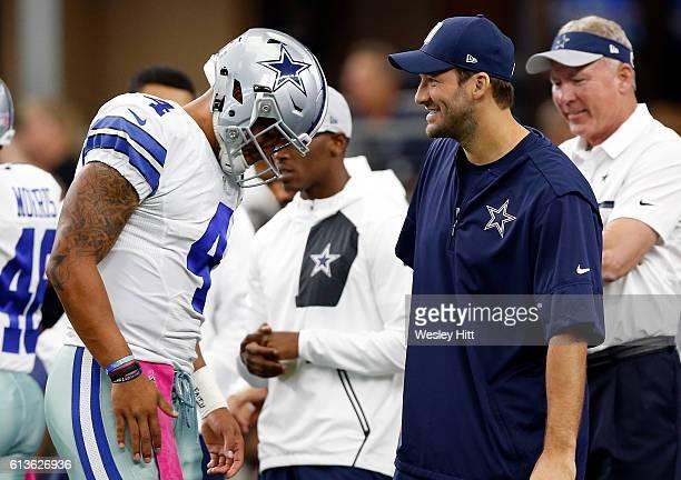 Dak Prescott quarterback of the Dallas Cowboys talks with injured quarterback Tony Romo prior to the game against the Cincinnati Bengals at ATT...