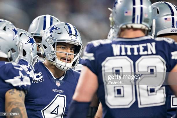 Dak Prescott talks in the huddle with Jason Witten of the Dallas Cowboys during a game against the Los Angeles Chargers at ATT Stadium on November 23...