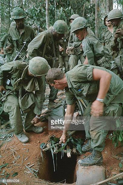 Plasma is given to a wounded member of the 173rd Airborne Brigade on Hill 875 as he is carried on a stretcher through the densely wooded area