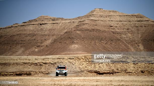 Dakar rally manager of the road book Pablo Eli and sports coordinator Edo Mossi drive on October 18 2019 in Saudi Arabia during the recce for the...