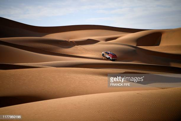 Dakar rally manager of the road book Pablo Eli and sports coordinator Edo Mossi drive on October 18, 2019 in Saudi Arabia during the recce for the...