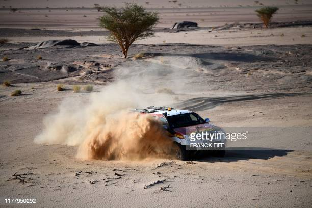 Dakar rally manager of the road book Pablo Eli and sports coordinator Edo Mossi drive on October 17, 2019 in Saudi Arabia during the recce for the...