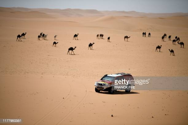 Dakar rally manager of the road book Pablo Eli and sports coordinator Edo Mossi drive on October 16, 2019 in Saudi Arabia during the recce for the...