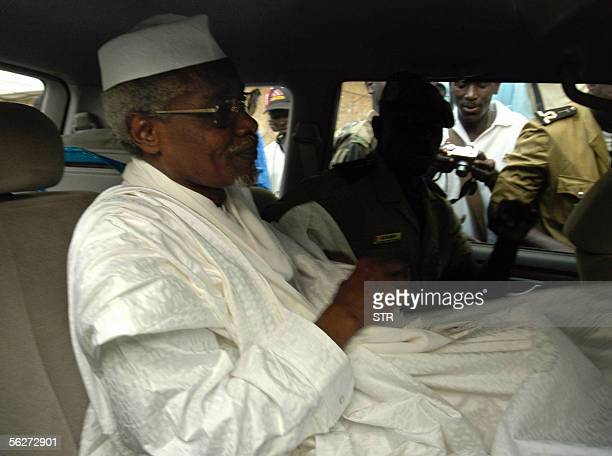 Chad's ex-dictator Hissene Habre leaves Dakar's courthouse escorted by prison guards 25 November 2005. A Senegal court 25 November disqualified...