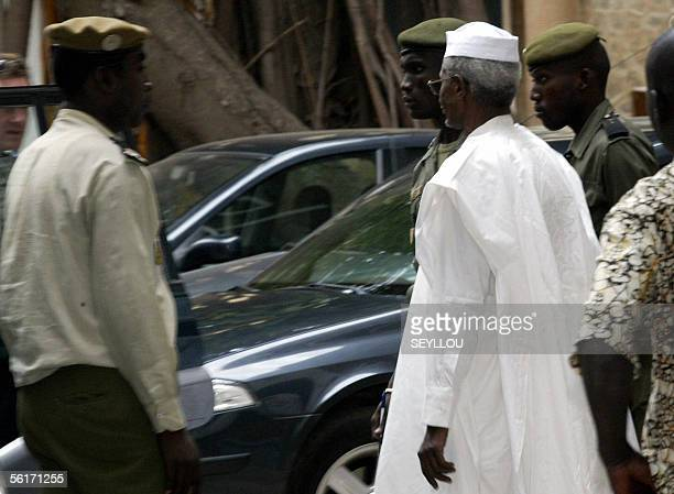 Chad's former President Hissene Habre is escorted by policemen at Dakar's justice court, 15 November 2005. Habre was arrested on Tuesday and taken to...