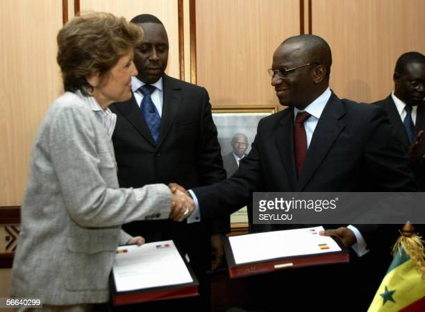 French Ministerdelegate for the Cooperation Development and Francophony Brigitte Girardin exchanges signed copies of a cooperation accord with...