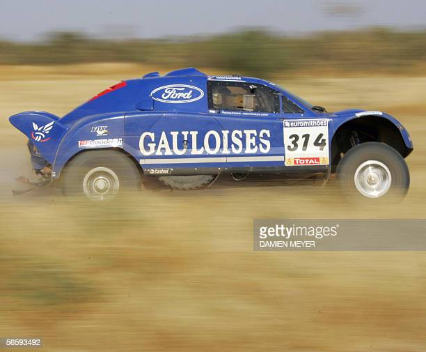 Frenchman JeanLouis Schlesser steers his car to finish fourth of the 14th stage of the 28th Dakar 14 January 2006 between Tambacounda and Dakar...
