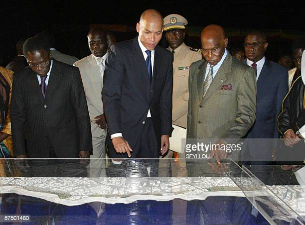 Senegalese President Abdoulaye Wade listens late 30 April 2006 to his son Karim Wade president of the National Agency of the Organization of the...