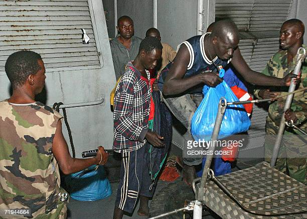 Senegalese wouldbe immigrants arrive at the port of Dakar after being intercepted by Senegalese coast guards 20 September 2006 Over 420 Senegalese...