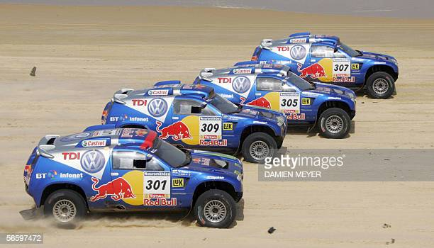 Volkswagen cars France's Bruno Saby US Mark Miller South Africa's Giniel De Villiers and Spain's Carlos Sainz ride on the beach of Dakar during the...