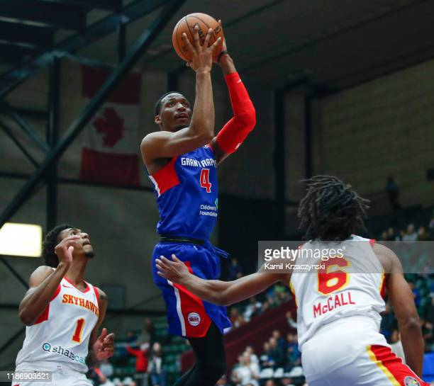 Dakarai Allen of the Grand Rapids Drive shoots against Tahjere McCall of the College Park Skyhawks during the second half of an NBA GLeague game on...