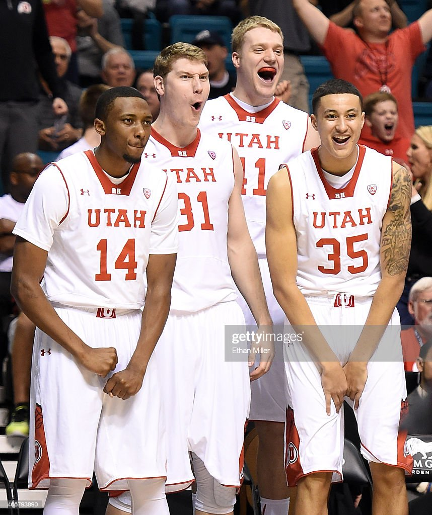 Dakarai Tucker #14, Dallin Bachynski #31, Jeremy Olsen #41 and Kyle Kuzma #35 of the Utah Utes celebrate on the bench late in their quarterfinal game of the Pac-12 Basketball Tournament against the Stanford Cardinal at the MGM Grand Garden Arena on March 12, 2015 in Las Vegas, Nevada. Utah won 80-56.