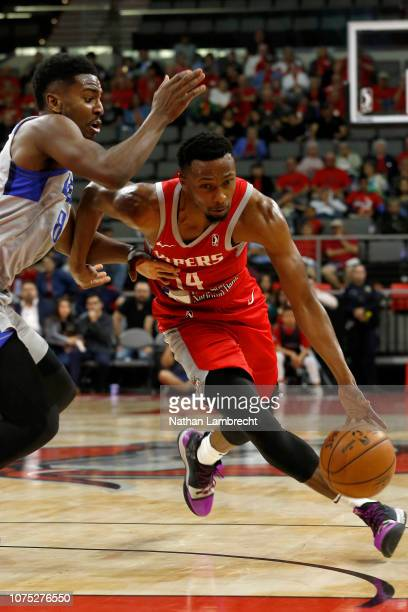 Dakarai Tucker of the Rio Grande Valley Vipers drives to the net on Donte Ingram of the Texas Legends during an NBA GLeague game at the Bert Ogden...