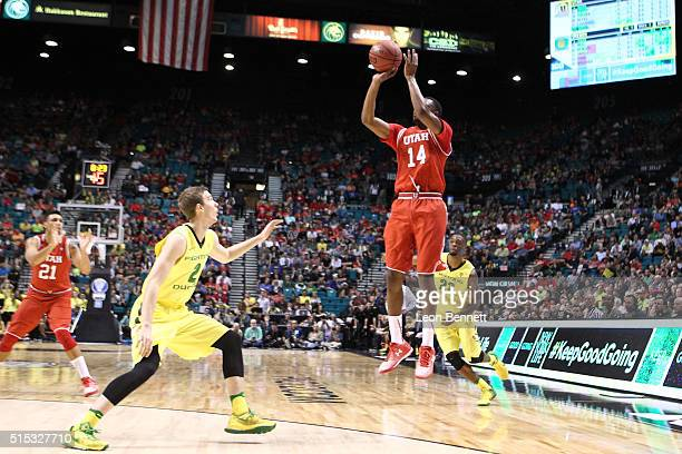 Dakarai Tucker of the Utah Utes shoots the ball for three over Casey Benson of the Oregon Ducks during the championship game of the Pac12 Basketball...