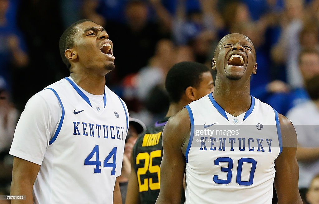 Dakari Johnson #44 and Julius Randle #30 of the Kentucky Wildcats react after Randle drew a foul against LSU Tigers during the quarterfinals of the SEC Men's Basketball Tournament at Georgia Dome on March 14, 2014 in Atlanta, Georgia.