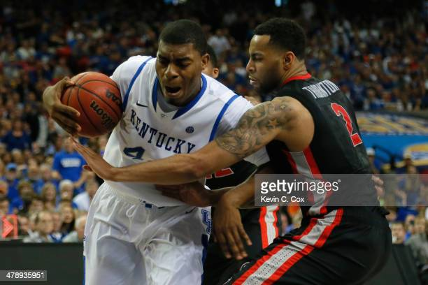Dakari Johnson of the Kentucky Wildcats drives with the ball against Marcus Thornton of the Georgia Bulldogs during the semifinals of the SEC Men's...