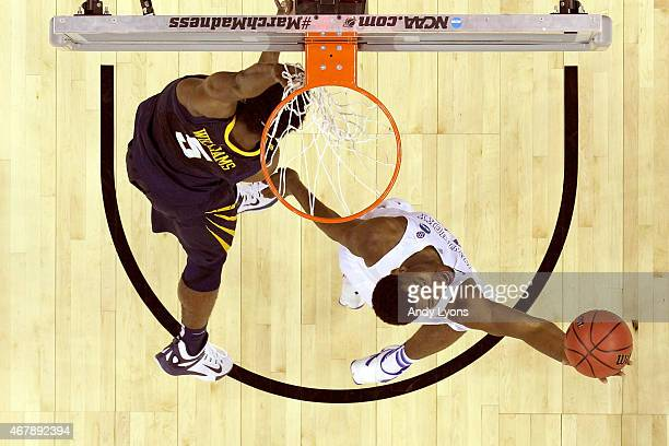 Dakari Johnson of the Kentucky Wildcats grabs a rebound against Devin Williams of the West Virginia Mountaineers during the Midwest Regional...