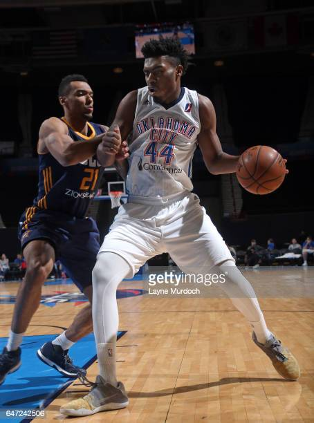 Dakari Johnson of the Oklahoma City Blue dribbles the ball while guarded by Joel Bolomboy of the Salt Lake City Stars during an NBA DLeague game on...