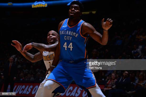Dakari Johnson of the Oklahoma City Thunder boxes out against Jameer Nelson of the Denver Nuggets on October 10 2017 at the Pepsi Center in Denver...
