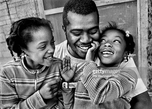 FILE Dakeitta Sample and her sister Courtney Sample are glad to see their father Lawerence Collins Jr after he came home from work in Bayview...