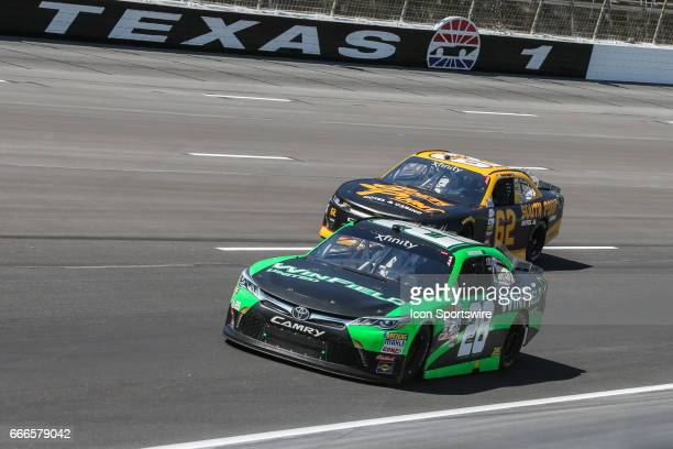 Dakoda Armstrong leads Brendan Gaughan in turn 1 during the My Bariatric Solutions NASCAR Xfinity Series race on April 8 2017 at Texas Motor Speedway...