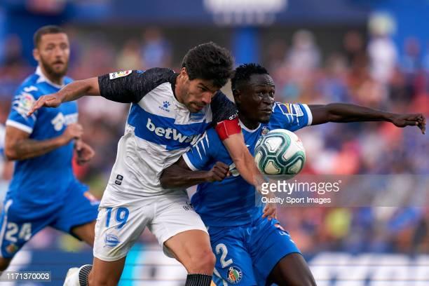 Dakonam Djene of Getafe CF battles for the ball with Manuel Alejandro of Deportivo Alaves during the Liga match between Getafe CF and Deportivo...
