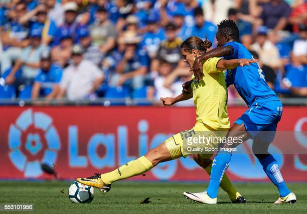 Dakonam Djene of Getafe competes for the ball with Enes Unal of Villarreal during the La Liga match between Getafe and Villarreal at Coliseum Alfonso...