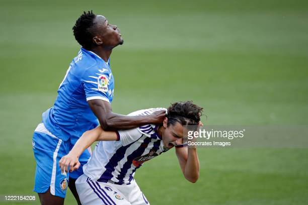 Dakonam Djene of Getafe, Enes Unal of Real Valladolid during the La Liga Santander match between Real Valladolid v Getafe at the José Zorrilla...