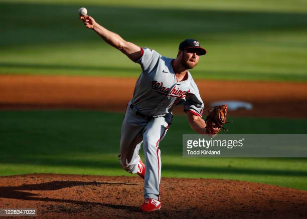 Dakota Bacus of the Washington Nationals delivers the pitch in the sixth inning of game one of an MLB doubleheader against the Atlanta Braves at...