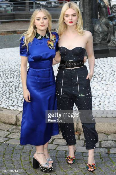 Dakota Fanning and Elle Fanning arrive at the Miu Miu show as part of the Paris Fashion Week Womenswear Spring/Summer 2018 on October 3 2017 in Paris...