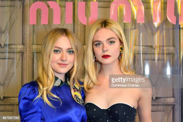 Dakota Fanning and Elle Fanning attend the Miu Miu show as part of the Paris Fashion Week Womenswear Spring/Summer 2018 on October 3 2017 in Paris...