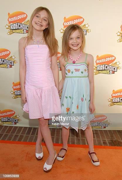 Dakota Fanning and Elle Fanning during Nickelodeon's 20th Annual Kids' Choice Awards Orange Carpet at Pauley Pavilion in Westood California United...