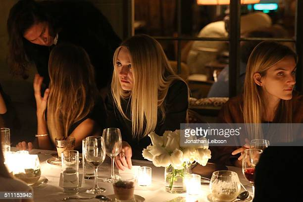 Dakota Fanning and Gaia Repossi attend the REPOSSI Los Angeles Dinner at Chateau Marmont on February 17 2016 in Los Angeles California