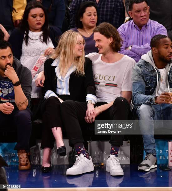 Dakota Fanning and Henry Frye attend New York Knicks vs Detroit Pistons game at Madison Square Garden on March 31 2018 in New York City