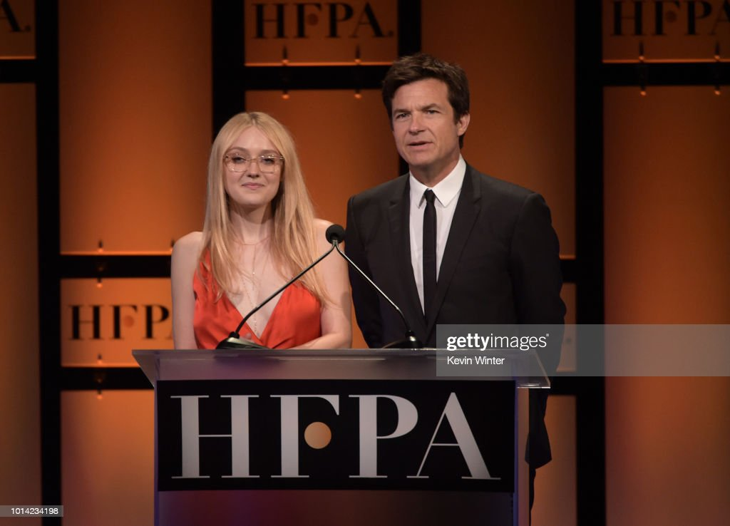 Dakota Fanning (L) and Jason Bateman speak onstage during the Hollywood Foreign Press Association's Grants Banquet at The Beverly Hilton Hotel on August 9, 2018 in Beverly Hills, California.