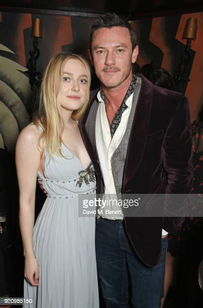 Dakota Fanning and Luke Evans attend the LOVE and MIU MIU Women's Tales Party at Loulou's on February 19 2018 in London England