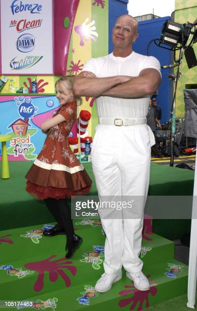 Dakota Fanning and Mr Clean having good clean fun at The Cat in the Hat premiere