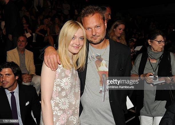 Dakota Fanning and Photographer Jurgen Teller attend the Marc Jacobs Collection Spring 2012 Front Row at NY State Armory on September 15 2011 in New...