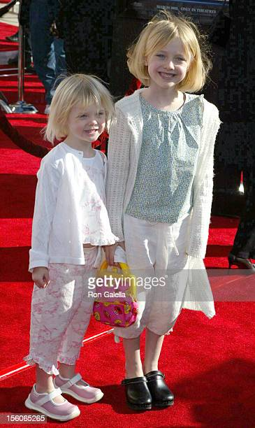 Dakota Fanning and Sister during 20th Anniversary Premiere of Steven Spielberg's 'ET The ExtraTerrestrial' Red Carpet at Shrine Auditorium in Los...