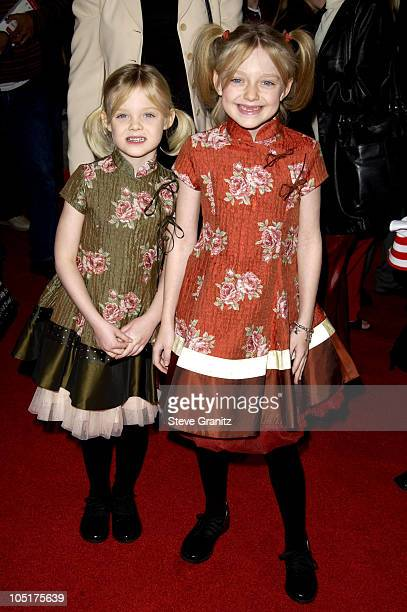 Dakota Fanning and sister Elle during The Cat In The Hat World Premiere at Universal Studios Cinema in Universal City California United States