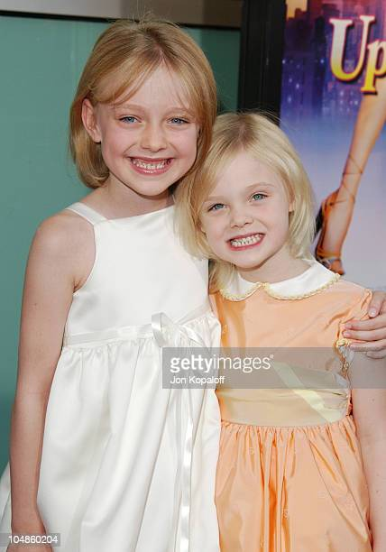 Dakota Fanning and sister Elle Fanning during Uptown Girls Los Angeles Premiere at ArcLight Cinerama Dome in Hollywood California United States