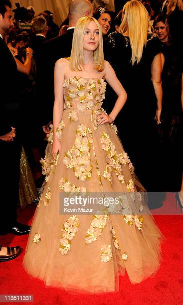 Dakota Fanning attends the Alexander McQueen Savage Beauty Costume Institute Gala at The Metropolitan Museum of Art on May 2 2011 in New York City