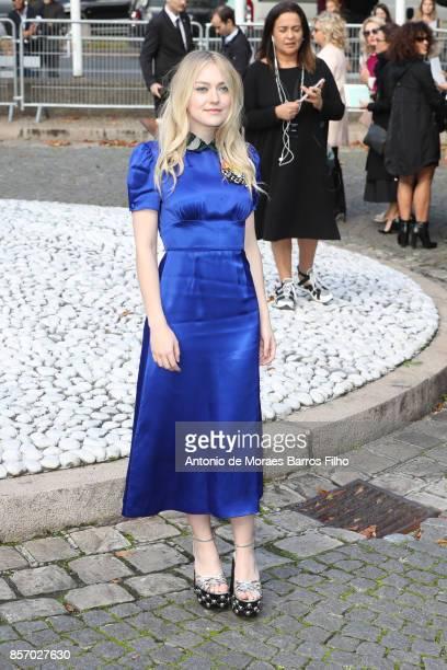 Dakota Fanning attends the Miu Miu show as part of the Paris Fashion Week Womenswear Spring/Summer 2018 on October 3 2017 in Paris France