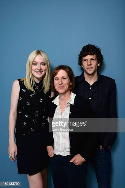 Dakota Fanning director Kelly Reichardt and actor Jesse Eisenberg of 'Night Moves' pose at the Guess Portrait Studio during 2013 Toronto...