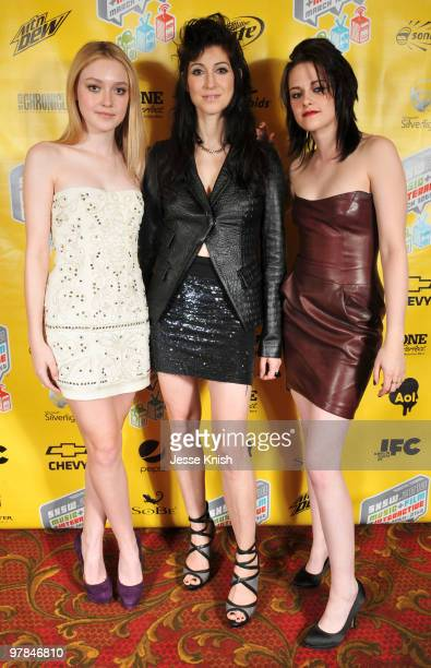 Dakota Fanning Floria Sigismondi and Kristen Stewart attend the movie premiere of The Runaways during the 2010 SXSW Festival on March 18 2010 in...
