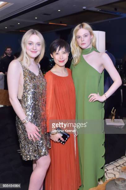Dakota Fanning Jimmy Choo Creative Director Sandra Choi and Elle Fanning attend The Hollywood Reporter and Jimmy Choo Power Stylists Dinner on March...
