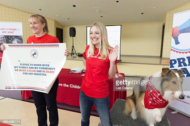 Dakota Fanning joins Save the Children's animal ambassador Lassie and Sarah Thompson in a pledge for disaster preparedness at a special...