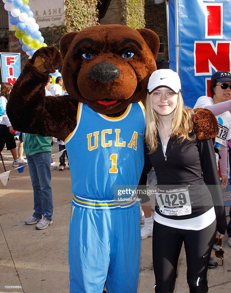 Dakota Fanning poses with 'Joe Bruin' at the 11th Annual 5K Mattel Children's Hospital UCLA Benefit held at UCLA Campus on May 23, 2010 in Westwood, California.