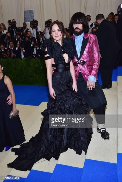 Dakota Johnson and Alessandro Michele arrive at 'Rei Kawakubo/Comme des Garcons Art Of The InBetween' Costume Institute Gala at The Metropolitan...
